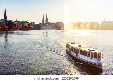 historic steam boat on Alster Lake in Hamburg, Germany in golden sunlight