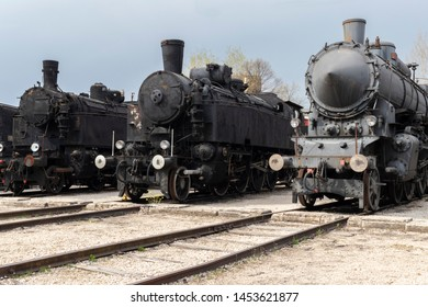 Historic steam locomotives on display at the Hungarian Railway Museum. Front view.