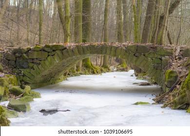 The historic stone bridge over a creek