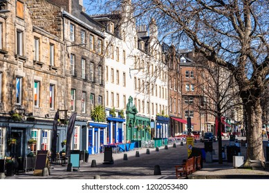 Historic Stone Buildings with Colourful Shopfronts at the Ground Level in Edinburgh Old Town on a Sunny Winter Day