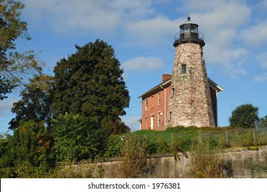 Historic stone lighthouse on Lake Ontario, Rochester, New York
