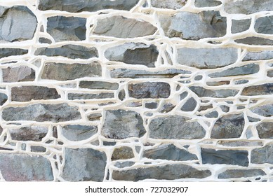 Historic Stone Wall Detail from 1700's residence with raised mortar joints.