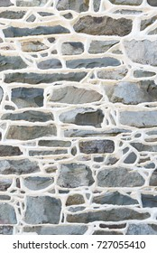 Historic Stone Wall Detail from 1700's residence with raised mortar joints. Portrait View.