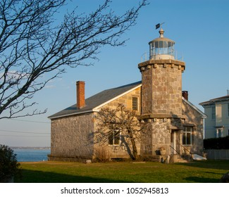 Historic Stonington Harbor lighthouse with its unique architecture made of stone and is used as a public library. It is without a lantern in its tower.