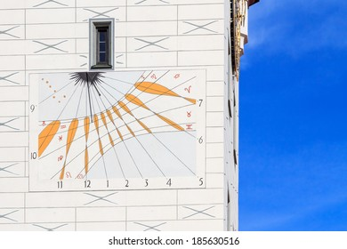 Historic sundial on a church tower in Munich, Germany
