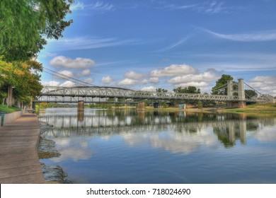 The Historic suspension bridge over the Brazos River in Waco Texas, built in 1870