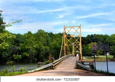 Historic suspension bridge over the White River is a historical landmark.  Located in Beaver, Arkansas just Northwest of Eureka Springs, Arkansas.