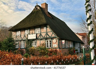Historic thatched roof German 'Fachwerk' house near Hamburg at Christmas time