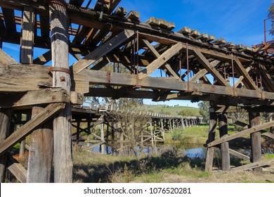 Historic timber railway bridge and the Prince Alfred Road Bridge over river and Murrumbidgee flats in Gundagai, New South Wales, Australia.