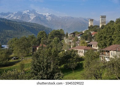 Historic tower houses stand amid more modern homes on a hillside in Mestia, Svaneti region of the Caucasus Mountains, Georgia