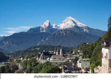 historic town of Berchtesgaden, Bavaria, Germany, with famous mountain Watzmann with fresh snow in summer