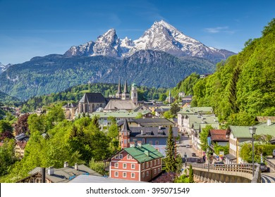 Historic town of Berchtesgaden with famous Watzmann mountain in the background on a sunny day with blue sky and clouds in springtime, Nationalpark Berchtesgadener Land, Upper Bavaria, Germany