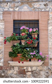 Historic town of Lugnano in Teverina (Terni, Umbria, Italy) at summer. Old typical street, flowered window
