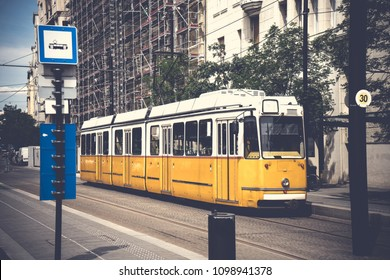 Historic tram running at tram station in  the city town in Budapest Hungary with   vintage style.