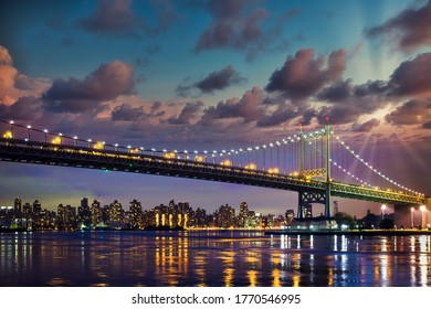 Historic Triborough Bridge from Astoria Queens towards New York City Manhattan after sunset with city lights
