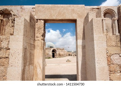 Historic Umayyad Mosque (as seen through ancient stone archway) in the Amman Citadel - Amman, Jordan