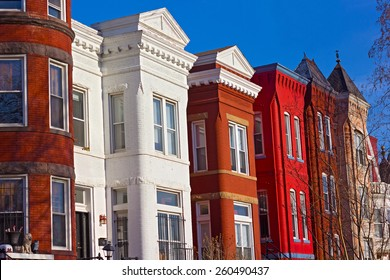 Historic urban architecture of Mount Vernon Square in Washington DC. Colorful residential row houses under bright afternoon sun.