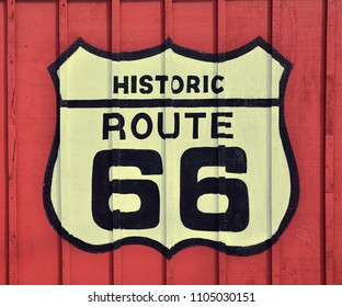 Historic U.S. old Route 66 sign with wooden background.