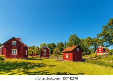 Historic village with ancient red wooden houses in Sweden