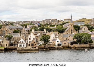 historic village of Stromness on Orkney mainland, Scotland, Uk. Seaside view of this fisherman town at Hoy sound  - Shutterstock ID 1734277373