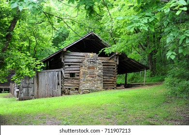 Historic Villines Cabin, Boxley Valley, in the Arkansas Ozarks is made of notched, hand-hewn logs.  Cabin has stone chimney and is has one room.