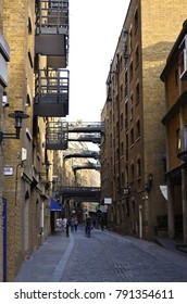 Historic walkway through the Shad Thames with brick buildings in Bermondsey - London, Great Britain - 08/01/2015