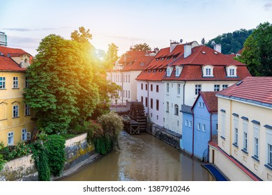 Historic water mill in Prague, Czech Republic. Old water mill at center of the Prague. Czechia. Mill Wheel of Velkoprevorsky Mill on Chertovka River in Prague, Czech Republic