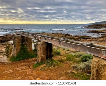 Historic Water Wheel at Cape Leeuwin during evening, on rocky coastal area south-westerly of the Western Australia