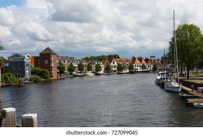 Historic waterfront in Harlem, The Netherlands, Europe with river and buildings