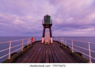 The historic West Pier beacon at Whitby, North Yorkshire, UK