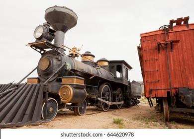 Historic western frontier pioneer railroad train locomotive iron steel steam engine parked near Tucson, Arizona, AZ, USA