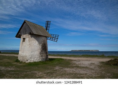 Historic windmill on the island of Gotland, Sweden with Lilla Karlsö island in the background