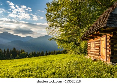 Historic wooden cottage and evening on mountains - Little Fatra hills National Park, Slovakia, Europe