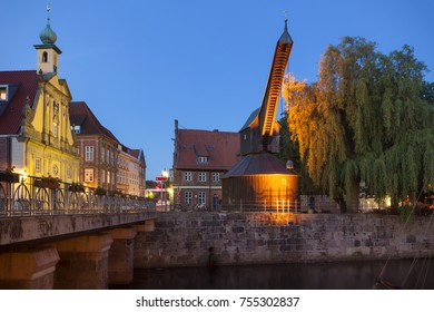 Historic wooden crane and old warehouse at Luneburg at the blue hour