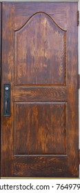 A historic wooden door with handle and lock