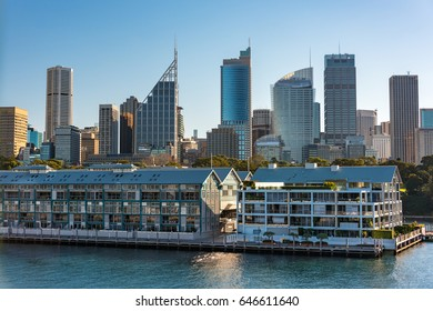 Historic Woolloomooloo wharf with Sydney CBD skyline skyscrapers on the background. Sydney cityscape on sunny day