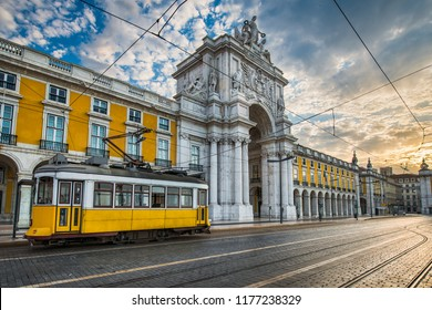 Historic yellow tram in front of Arco da Rua Augusta in Lisbon, Portugal