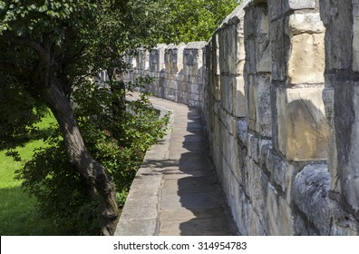 The historic York City Walls in York, England.  Since Roman times, the city of York has been defended by walls and substantial portions of these still remain today.