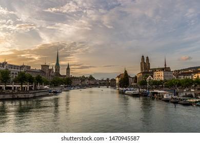 Historic Zurich downtown skyline with Fraumunster and Grossmunster churches at lake zurich during sunset, Switzerland.