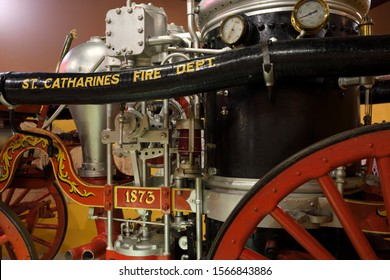 Historical 1873 Steam engine water Pumper of the St. Catherines Fire Department at the St. Catharines Museum & Welland Canals Centre, St Catherines, Ontario, Canada - August 17, 2019