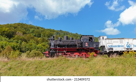 Historical 19th century Steam Locomotive at the Medieval Castle Ruin Neideck in the Franconian Swiss of Germany. In Bavaria north of Munich