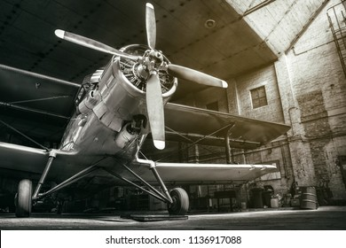 historical airplane in an hangar