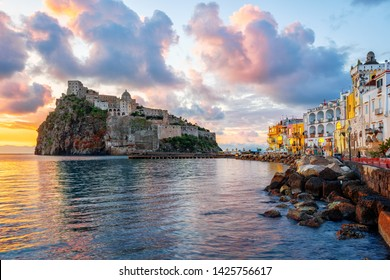 Historical Aragonese castle on a rock in Mediterranean sea, Ischia island, Gulf of Naples, Italy, in dramatic sunrise light