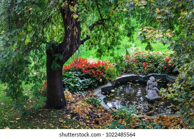 historical beautiful fountain in old Europe city park in autumn