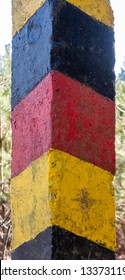 Historical black-red-golden border post at the former border between the German Democratic Republic (GDR) and the Federal Republic of Germany (FRG), close-up view