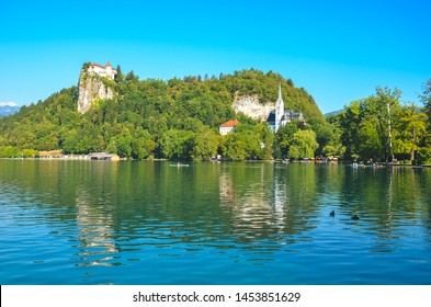 Historical Bled Castle surrounded by beautiful lake in Bled, Slovenia. Bled Lake is a popular travel destination and popular holiday spot. History, ancient, Europe