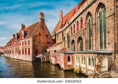 Historical brick buildings along beautiful canals in spring in Bruges, Belgium