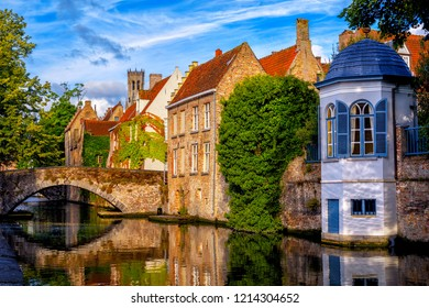 Historical brick houses on a canal in Bruges medieval Old Town, Belgium