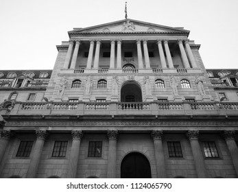The historical building of the Bank of England in London, UK at night in black and white