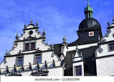 The historical building. The castle in the city of Wolfsburg. Germany. against the blue sky. calaxery and clock.